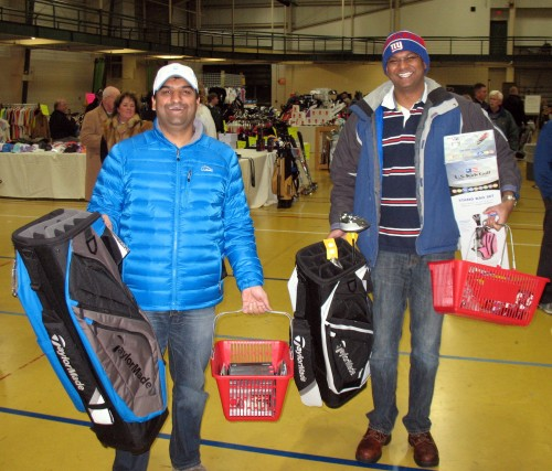 """Bhavin Shah and Sabari Jayaseelan are proud of their purchases. Shah got five dozen balls and five gloves, plus the bag. Jayaseelan got a bag and SLDR driver from Edison Club and a starter set for his 5 1/2 year old daughter from Mohawk Golf Club. Negotiating, """"that's the best part,"""" says Jayaseelan."""