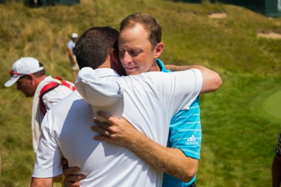 PGA Club Professional Brian Gaffney hugs PGA of America President Derek Sprague on the 18th green during the Final Round at the 97th PGA Championship at Whistling Straits on August 16, 2015 in Sheboygan, WI. (Photo by Mike Ehrmann/The PGA of America)