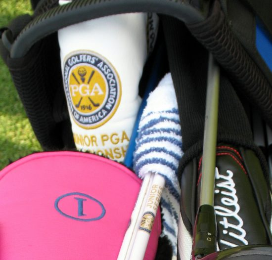 Deep inside Braman's bag with Junior PGA Championship putter headcover and alignment sticks.