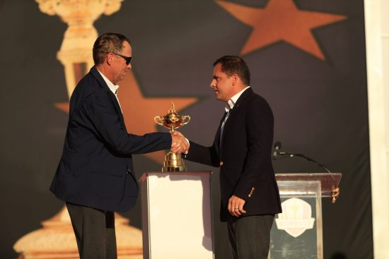CHASKA, MINNESOTA - OCTOBER 2: The PGA President, Derek Sprague, shakes hands with the United States Team Captain, Davis Love III, during the Trophy Presentation for the 41st Ryder Cup at Hazeltine National Golf Course on October 2, 2016 in Chaska, MN. (Photo by Mike Ehrmann/PGA of America)